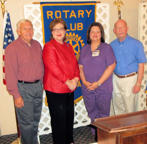 Pictured front left to right are Rotarian George Rhymes, Tammie Arnold, Lisa Trammel, and the Rotarian with the program, Bob Gillan.