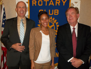 Pictured front left to right are James Dixon, Jr,  Dr. Tiffany Simpson, and  the Rotarian with the program, Brett Brunson.