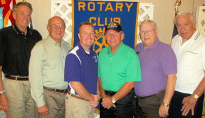 Pictured from left to right are Rotarians Henry Kinburger, Bill Finical, LTC Macky Underwood, Fred Terasa, Richard White, and the Rotarian with the program, Dr. Larry Burke.